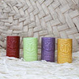 Four Tiki Cocktail Mugs - green, red, purple, orange - tiki background