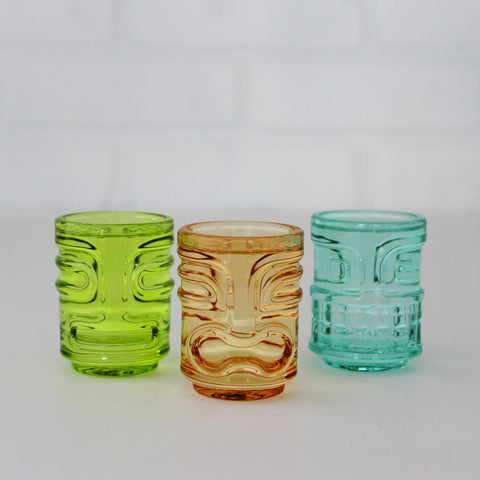 Three Tiki Shot Glasses - green, orange, blue - two stacked