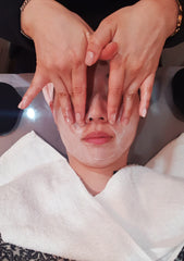 Therapist cleansing the skin to remove dirt and impurities