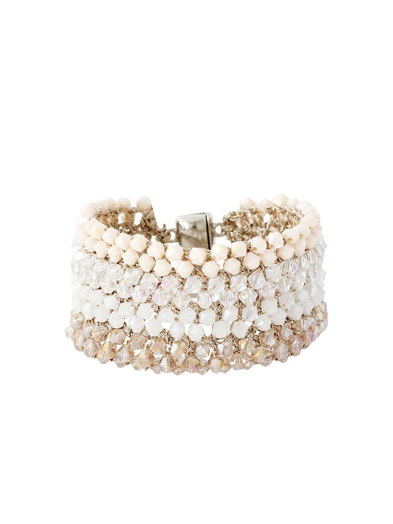 Stunning hand-woven crochet beaded statement bracelet. Shades of soft ivory, blush, beige, and grey tones. Magnetic clasp closure. Perfect for brunch, night out, or any special occasion. Especially a wedding.