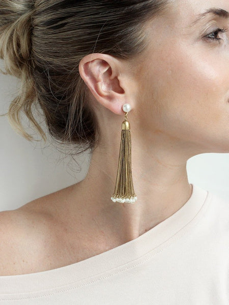 Gold chain tassel statement earrings with pearl accents at the bottom. Elegant and fun. Perfect for a night out or special occasion. Especially a wedding.