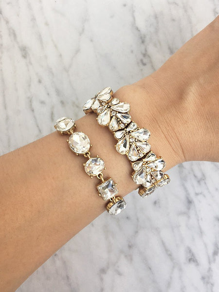 A stretch cuff of repeating teardrop clear crystals in a baroque floral petal silhouette. Wear for brunch, night out, or any special occasion. Especially a wedding.