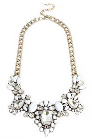 White cabochon, faceted gems, and clear crystals create this beautiful floral bib statement necklace with a chunky gold link chain. Elegant and fun. Perfect brunch, night out, or any special occasion. Especially a wedding.