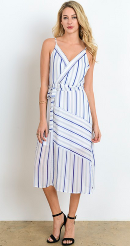 Blue, gold, and white striped lightweight midi dress featuring spaghetti straps, side slit, and sash tied wrap front.