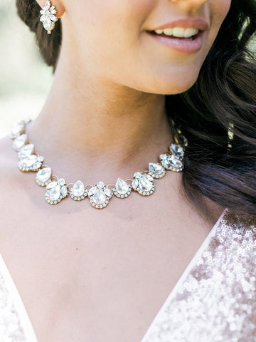 An array of clear crystal teardrops come together to create this stunning collar silver necklace. Classic, elegant and fun. Perfect for bridal, brunch, night out, or any special occasion. Especially a wedding.
