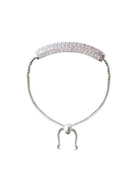 A sleek silver bracelet featuring a delicate bar encrusted with pave Cubic Zirconia. Elegant and fun. Perfect for brunch, night out, or any special occasion. Especially a wedding.