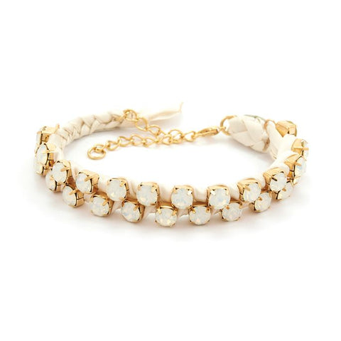 A cluster of glitzy white gemstones sit on this braided white satin bracelet for a classy yet simple style.