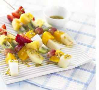 FROZEN FRUIT STICKS WITH PASSION FRUIT & LIME DRIZZLE