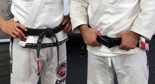 What does the rank bar on a BJJ belt mean?