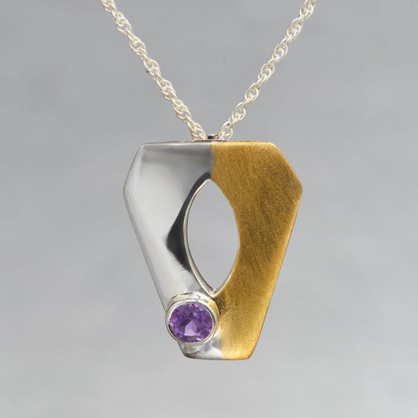 Simplicity at it's best. A lightweight, delicate sterling silver gold plated pendant is applauded for it's fine craftsmanship and elegant appeal. The pendant holds a 4mm round faceted amethyst gemstone.