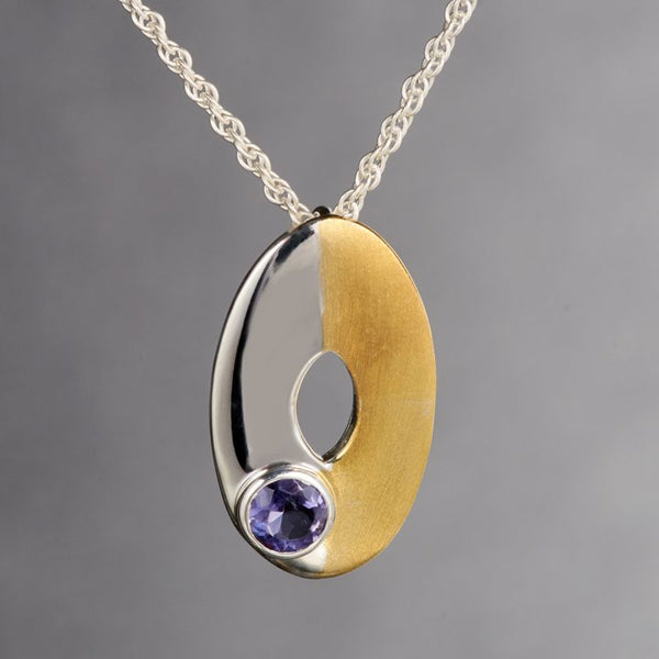 Cute dainty pendant with 2mm Iolite gemstone is mesmerizing! It is too cute to wear it, it should be held in your palms and you could look at it all day. Two tone sterling silver pendant is a perfect example of minimalist jewelry. 18Kt.gold plated on half the pendant adds character and style.