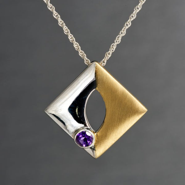 A square shaped, but when worn it looks more of a diamond shape pendant is, two toned-sterling silver on one side and sterling silver with gold plating on the other side. It has a 4mm amethyst gemstone which is embedded with perfection and finesse. The sides of the pendant is 2.15 cm each way. Each pendant has a .925 authenticity stamp on the back to ensure your purchase with a guarantee.