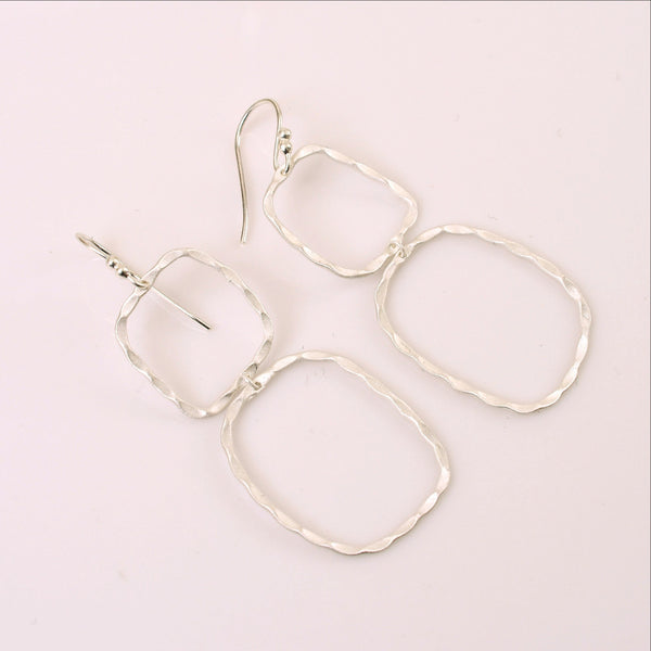 With a petite frame these delicate, hand hammered silver drop earrings are sure to complement your every style. Featherweight, dainty yet bold and beautiful