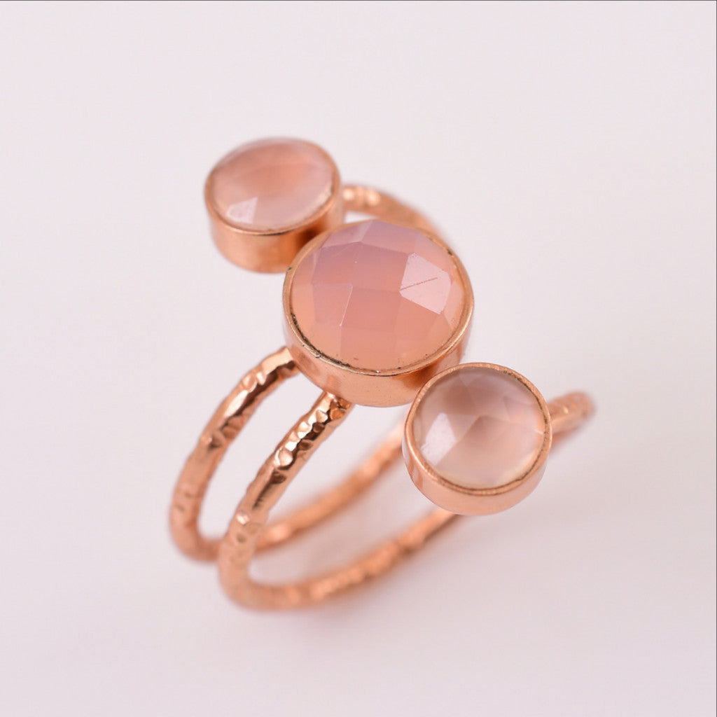 An adjustable, hand hammered textures rose gold ring, adorned with 3 beautiful rose quartz gemstones. Lightweight and flexible, this trendy ring can easily be adjusted to the fit you may need.