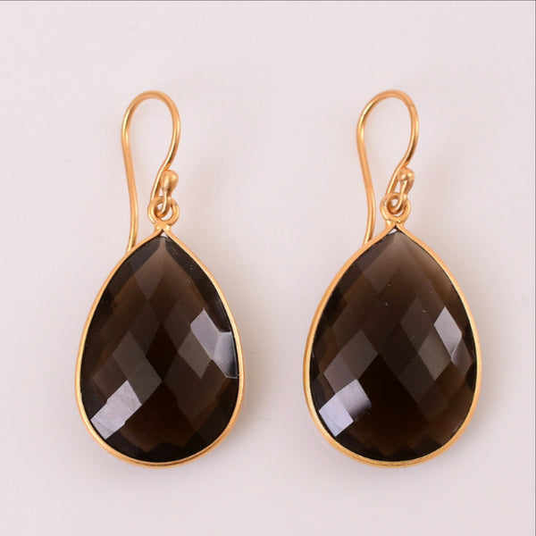 The popularity of the smoky quartz is not only for its gleaming and glistening appeal but for its affordability as a gemstone, and the energy it provides. Elegant teardrop earrings in18 kt gold are 4cm long and 2.25 cm wide.