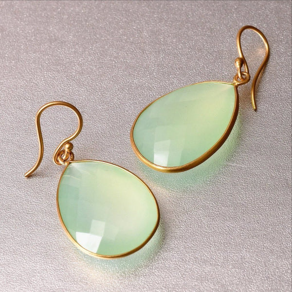 Weightless, chalcedony earrings flaunt it presence with pride and elegance. Sterling silver base with 18kt. gold plating, these glamorous drop earrings are 4cm long and 2.25 cm wide