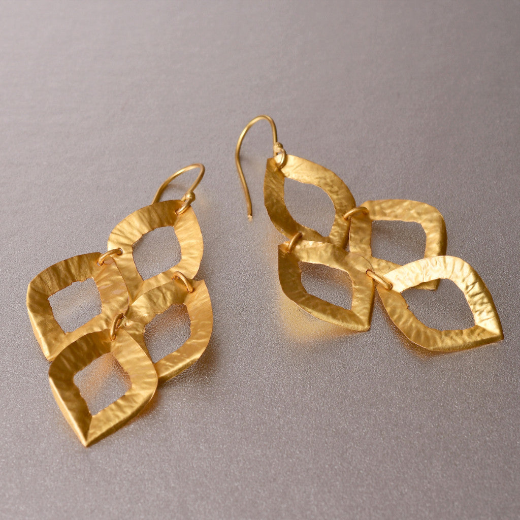A featherweight, handhammered pair of earrings with a boutique, luxe boho flair. You may literally forget you had these on, even if you wore them all day long. Jewelry with no weight what so ever, so ladies can enjoy showcasing their style which ever way they desired.