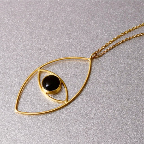 This beautiful luxe boho necklace adorned with black onyx in an inticate design of an 'evil eye' is far from subtle. A must-have layer of the season. Dress down or dress up.