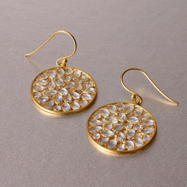 Mesmerizingly elegant and sophisticated pair of dangle earrings which are lightweight and dainty but showcase a bold, statement appeal. Embedded with yellow topaz, which is a stone to manifest your intentions, in alignment with the divine will.