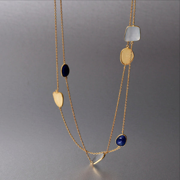 An everyday 20 1/2 inch layer 'Maia Necklace' with fine lapis lazuli and blue chalcedony gemstones brings that splash of color and style your attire may just need.