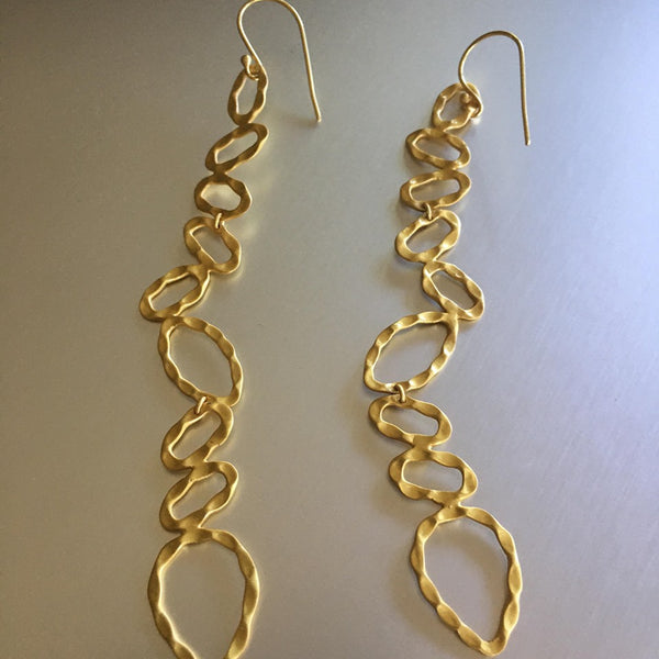 These gold plated over sterling silver, featherweight, almost 2 inches long, chic earrings are quite deceiving for they may seem heavy but are 'featherweight'. An elongated and preppy shape that will spruce any attire.