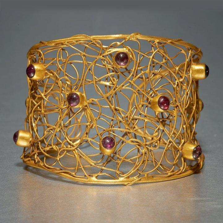 Simply Exquisite. Handmade, sterling silver base with 18kt. gold plating, this cuff is luxury at its best, a flawless and incomparable piece of jewelry. Amethyst gemstones dance freely thereby leaving behind that first impression that you will never ever forget. Limited Edition Piece.