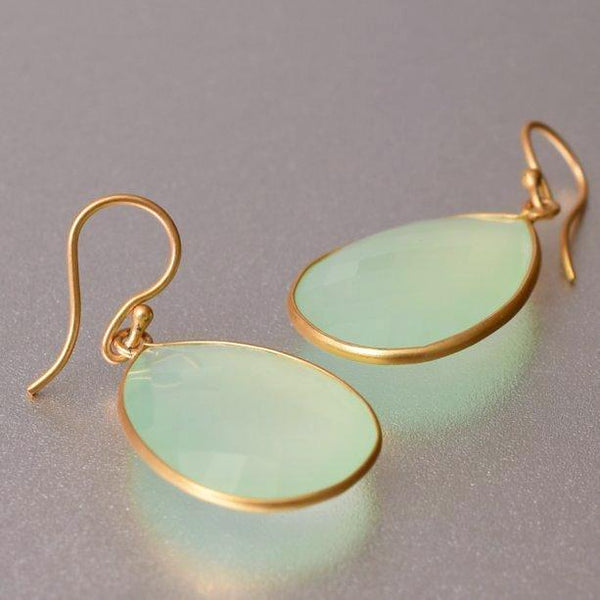 Chalcedony earrings, that are weightless yet flaunts it presence with pride and elegance. Sterling silver base with 18kt. gold plating, these drop earrings are 4cm long and 2.25 cm wide and fashion forward enough to transition from office to nightclub