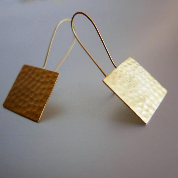 Looks can be deceiving. Lightweight yet bold in appearance, these hand hammered earrings are a beautiful culmination of style, elegance and poise.