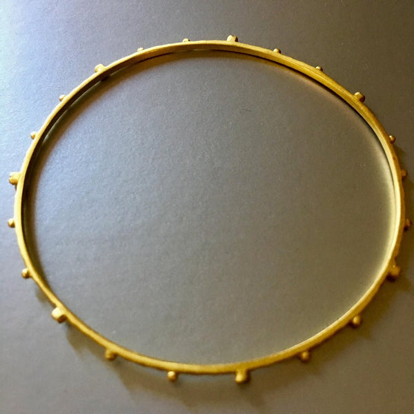 Dainty, petite and beautifully textured bangle bracelet with gold plating is a loveable, adorable, everyday bangle bracelet that you would not want to ever take it off. Stack it up and enjoy the soft jingling or enjoy them with other cuffs from Mia Siya.