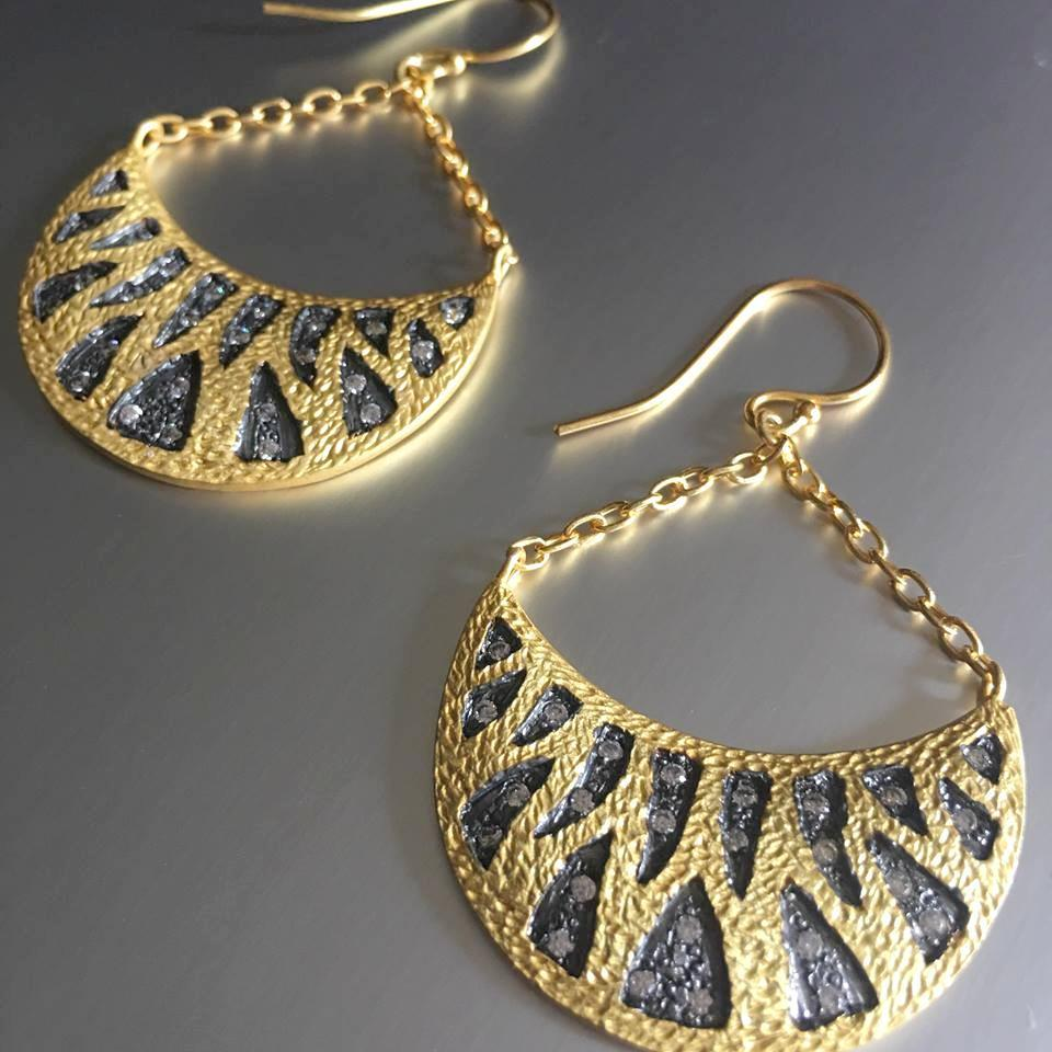 These semi-moon shaped, sterling silver with gold plating earrings could not look any prettier! A unique design that takes you forms a work zone to evening attire with a distinguished appeal. Cubic zirconia with black rhodium plating adds that touch of glamour and poise.