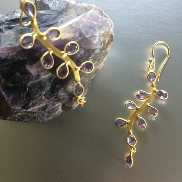 Looks can be deceiving! The saying can easily be used for these stunning Sanya Earrings with amethyst. Lightweight, delicate yet durable and bold, these playful earrings showcase amethyst gemstones so graciously that one may not imagine