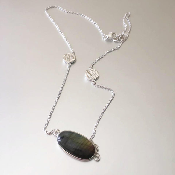 Dainty as can be, this flimsy yet durable sterling silver chain necklace with an adorable designed charm on each side and a glistening, striking labradorite pendant.