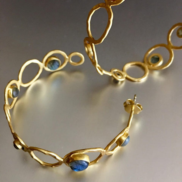 One of my personal favorite to look at since I can't wear anything more than a stud. A lover of jewelry, especially earrings but can't wear it but you can. Enjoy these stunning gold plated semi-hoop, enhanced with my favorite gemstones: labradorite. What can be more breathtakingly beautiful than that combination?