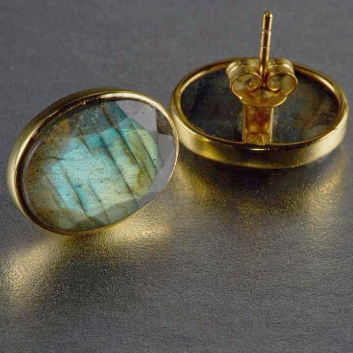 Delightful, adorable Leya labradorite studs are a cute addition to the Mia Siya family. Sterling silver gold plated studs with labradorite gemstones, a stone of magic. It protects against the negativity and misfortunes of this world, and provides safe exploration into alternate levels of consciousness and in facilitating visionary experiences from the past or the future.