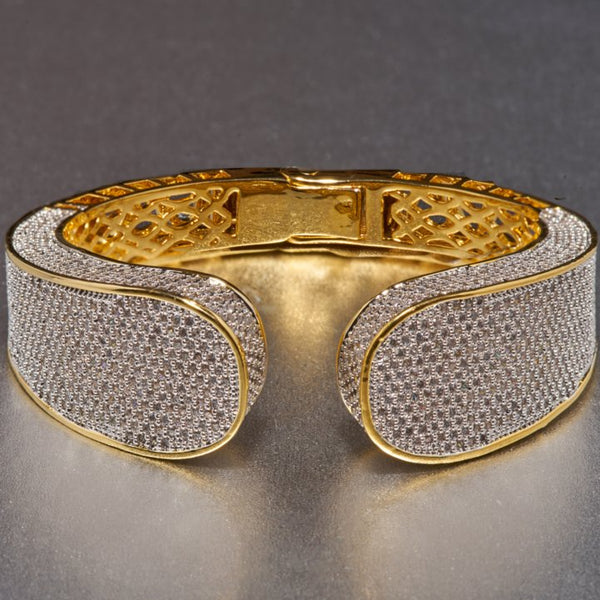 Luana bracelet is beautifully and masterfully embellished with cubic zirconia, which is a fabulous find for anyone who enjoys fine, luxurious taste in jewelry. This gold plated cuff, will go with a multitude of outfits, from casual to dressy and seamlessly transition from day to night.