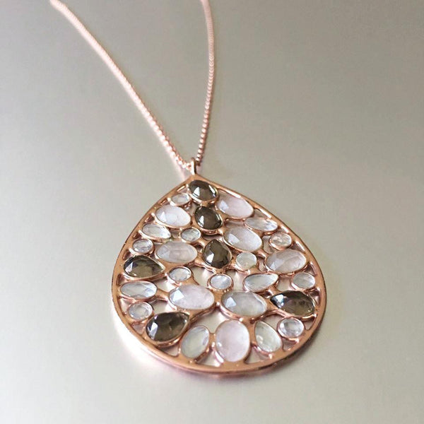 Simply flawless. A simple, teardrop design accentuating pink chalcedony, smoky quartz, and clear quartz is the latest addition to Mia Siya's Spring Collection. A pendant necklace that is loved for its classic, evergreen appeal and the ease of pairing it with casual as well as formal attire.