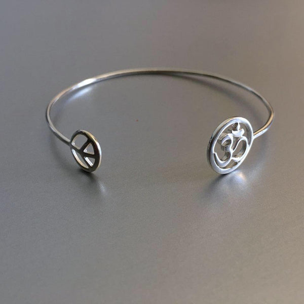 A beautiful melody: Peace charm with Om (infinity ) that evokes a rather spiritual air around you and the fashionista who follows the latest trends.  A striking sterling silver cuff.