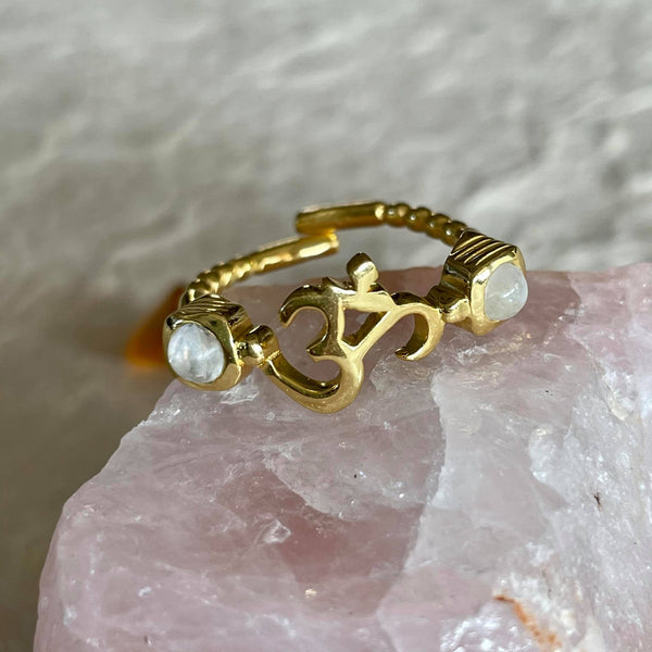 This beautiful adjustable, durable and comfortable ring with moonstone on each side, is simply mesmerizing. Hand-carved by jewelry master, in nickel-free brass, and plated with 18k gold, and always finished by hand. Wear it as a thumb ring or on your index, or any which way you choose the options are endless.