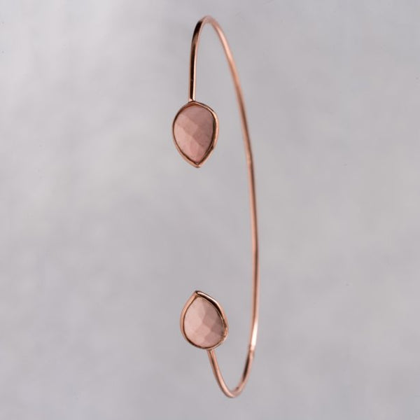 Lightweight, delicate, petite open cuff, enhanced with a gorgeous 3.02 carat of pink opal is mesmerizingly beautiful and eye-catching