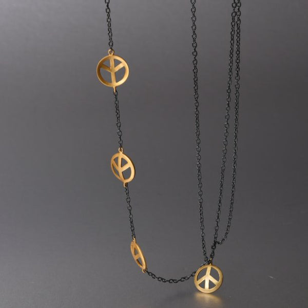 A unique sterling silver with gold plating design, where one side of the necklace holds cute little, gold plated peace charms and on the other side, 3 plain chains hence creating a playful, free spirited, luxe boho appeal. The necklace then holds another charm as a pendant.