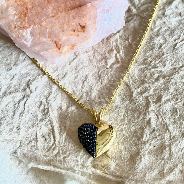 This exquisite blue sapphire necklace is one of a kind.This exquisite necklace is 1.25 inches in size, sapphires are round in shape and weigh 0.47 in carat amount. The chain is 16 1/2 inches in length. When worn it is almost 8 3/4 inches. Sits beautifully on the collar bone.