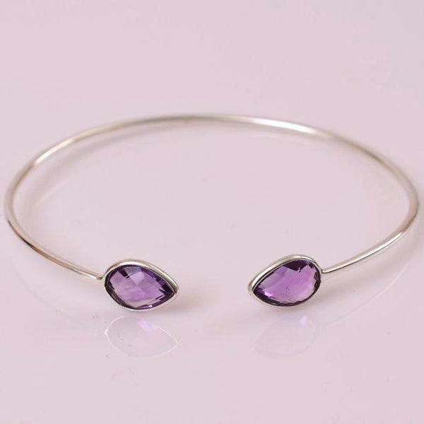 Dainty, lightweight amethsyt sterling silver cuff are simply divine. Amethyst is a meditative and calming stone which works in the emotional, spiritual, and physical planes to provide calm, balance, patience, and peace.