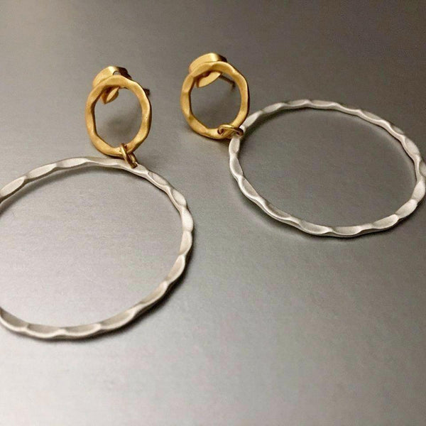 Hand-hammered earrings with a beautiful blend of sterling silver and gold plating make this adorable, lightweight hoop earrings a must-have for any wardrobe.
