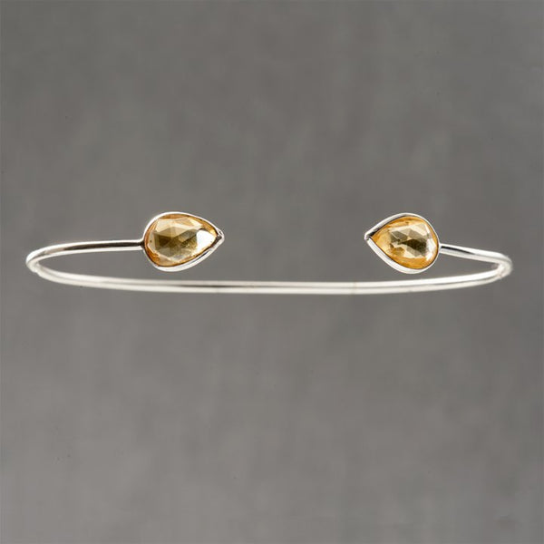 Sterling silver delicate cuff with yellow quartz may seem simple yet is an exquisite and classic piece of jewelry. Topaz is a stone to manifest your intentions, in alignment with Divine Will. This beautiful stone is a November birthstone. The energy of this stone attracts helpful people into your life that will benefit you, and may bring new friendships.