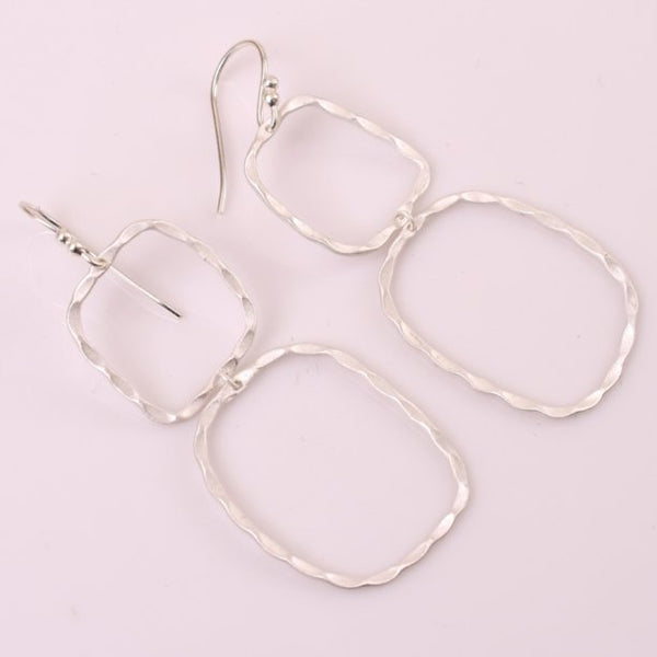 With a petite frame these delicate, hand hammered silver drop earrings are sure to complement your every style. Featherweight, dainty yet bold and beautiful. Perfect for your next getaway.