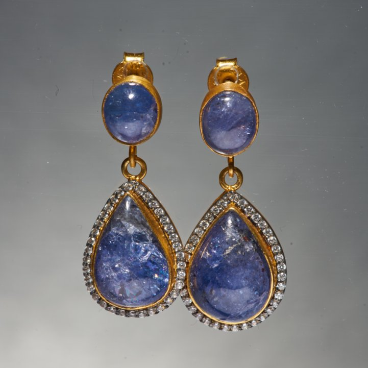 Our most iconic silhouette, the Kani Earrings with Tanzanite.  Its deep blue color is one of the most extravagant colours known to Man. It personifies immaculate, yet unconventional elegance. Tanzanite is considered to be a valuable spiritual stone that can be used in order to relate to other realms or for meditation.
