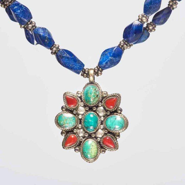 This vibrant and breathtakingly exquisite 18-inch necklace with unstructured 'lapis lazuli' gemstones is one of my personal favorites. A limited-edition necklace that surely can NOT be recreated. The necklace holds graciously a .925 sterling silver pendant which is embedded with beautiful 'turquoise and corals' gemstones.
