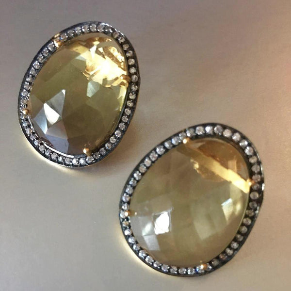 An exquisite pair of earrings that connect to your heart and soul with your first glance. A stunning yellow topaz earring studs, with cute little cubic zirconia circling the stud so harmoniously.