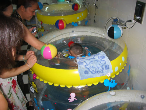 Baby being bathed in the orphanage