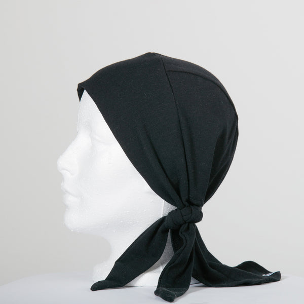 coKANna bamboo chemotherapy head scarf in black tied to the side